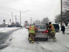 Crews push stuck cars on Centerville Road in East Hempfield Township.