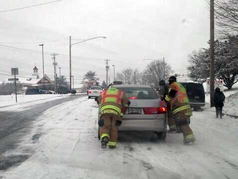 Crews push stuck cars on Centerville Road in East Hempfield Township.