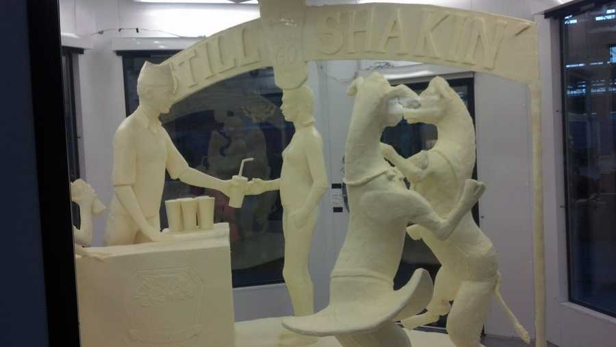 Thursday, Jan. 2: The butter sculpture at this year's Pa. Farm Show is a family drinking milkshakes while two cows dance. The sculpture is a celebration of the 60th anniversary of the Farm Show milkshake.