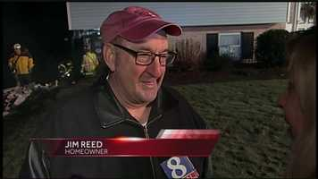 """""""We were in bed, of course, and heard a loud 'boom'. Didn't know what it was,"""" Reed said. """"So I investigated, and finally I saw a headlight inside my garage that I didn't put there."""""""