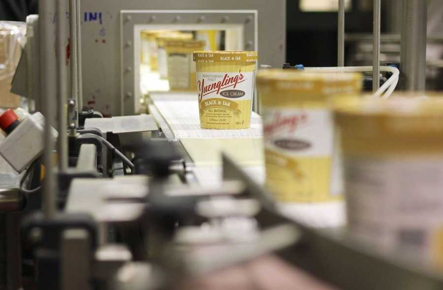 The first batches of Yuengling's ice cream, black and tan to be precise, are rolling off the assembly line in Tamacqua, Pa.