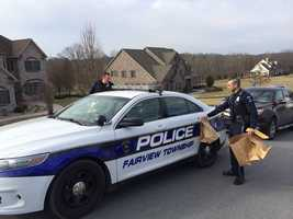 Police removed bags of evidence from the home Friday morning.