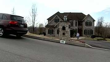 The house is located in an affluent neighborhood along Foxfire Lane.