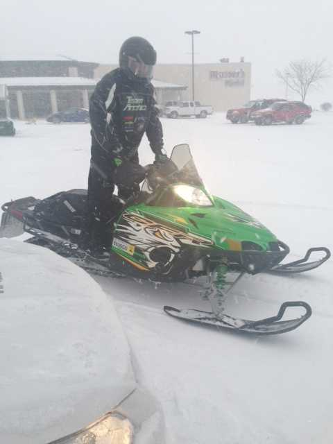 A snowmobile rider at The Buck.