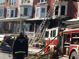 The fire started around 10 a.m. in a row home along the 200 block of Reservoir Street.