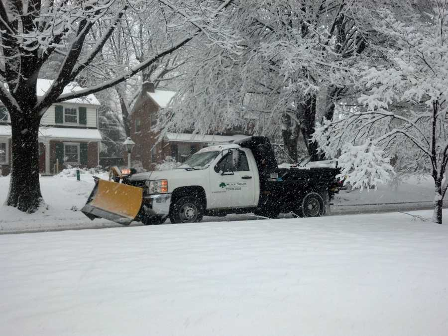 A plow heads down President Ave. near Harrisburg Pike in Lancaster, Monday, 9:30 a.m.