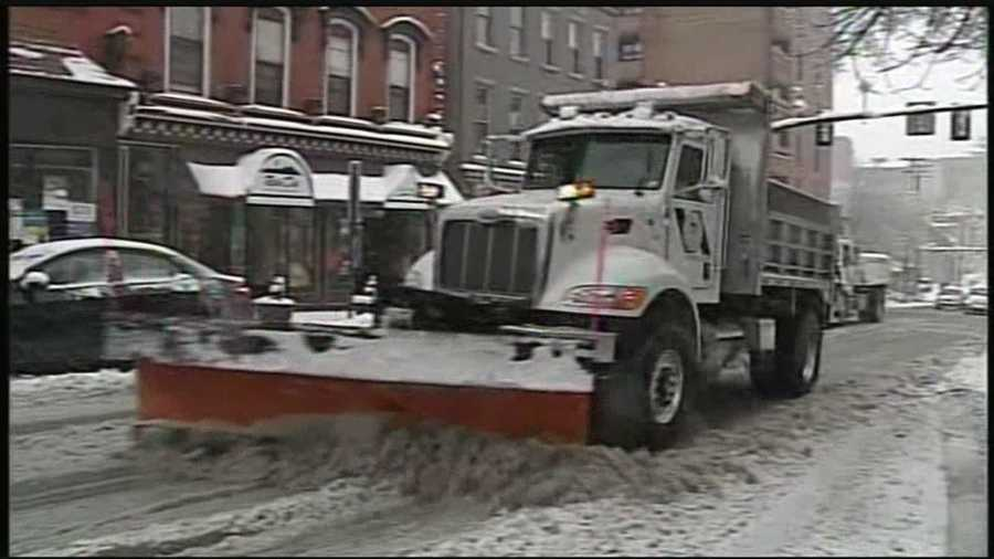 A plow clears a Lancaster street Monday morning.