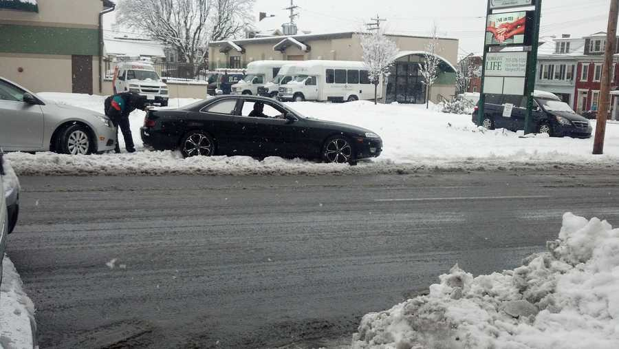 A car spins its wheels Monday afternoon in Lebanon.