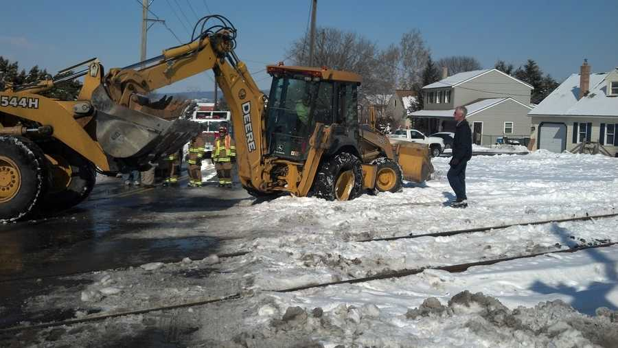 Firefighters tell News 8 a Denver Borough employee was driving a backhoe across the tracks when the train hit it.