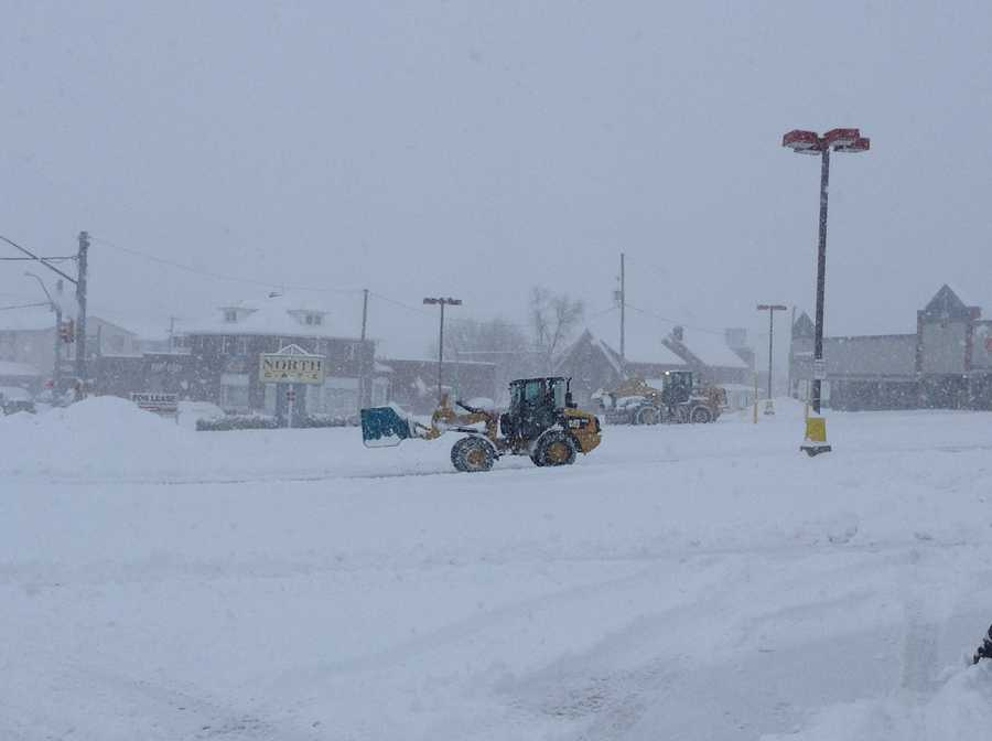 A bulldozer plows the York Shopping Center, 10 a.m. Thursday.