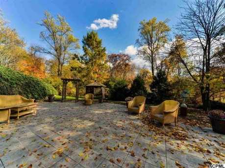 The home also features a large patios, outbuildings and a gazebo.