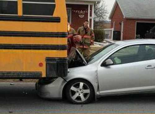 A car crashed into the back of a school bus Tuesday morning in Dover Township, York County.