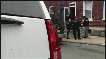 Police gather in front of a Lancaster home where a woman was stabbed multiple times on Wednesday morning.