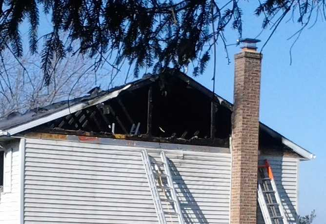 A woman who lived in the home was able to get out.