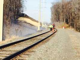 Firefighters say the dry brush around the train tracks enabled the fire to spread quickly.