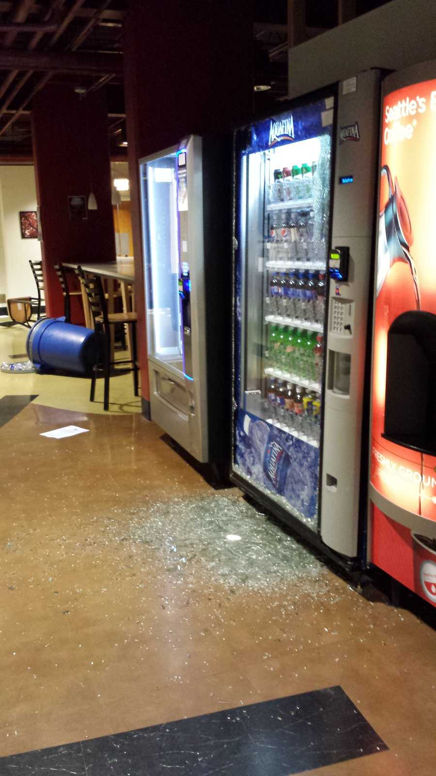 The vandalism inside of the building included smashed vending machine glass and overturned furniture and trash cans.