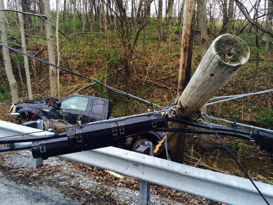 A pickup truck slammed into a utility pole, snapping it, in a Tuesday morning crash in Lancaster County.