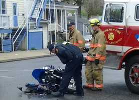 Officials say a shop lifting suspect crashed his motorcycle while trying to flee from police on Columbia Avenue.