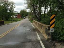Friday afternoon, water recedes along Jacobs Mill Road in western York County.
