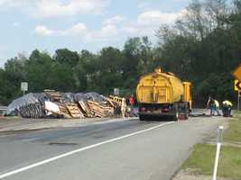 An overturned tractor trailer carrying mulch is blocking Route 30 between PA-462 and PA-74 in York County.