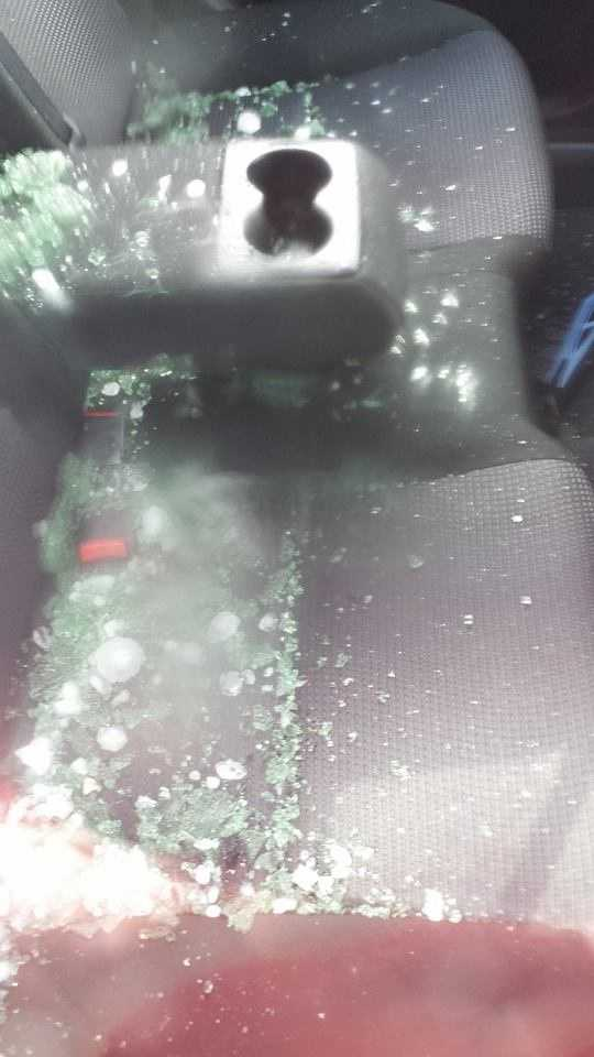 Glass and hail inside of a car parked at the Berkshire Mall.