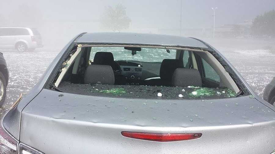 The hail shattered windshields and left glass scattered in and around the cars.