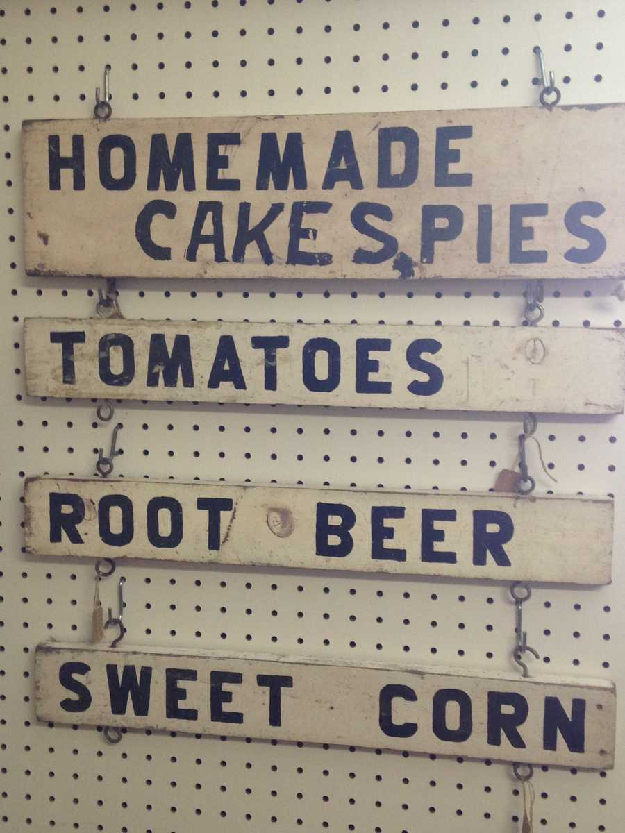 Antique shops sell an array of items, like this hand-painted sign that features goods for sale from a Lancaster County farm.