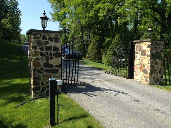 The day after the shooting - the front gate to the property is mangled.
