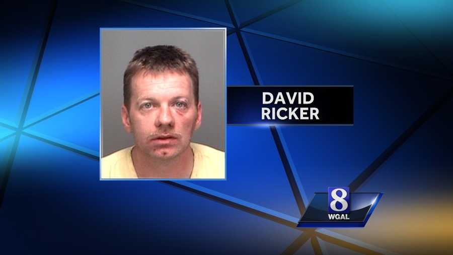 The shooter has been identified as 49-year-old David Ricker, shown in this mug shot from a 2009 arrest in Florida.