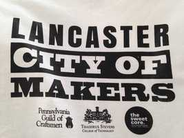 "Many visitors left the event with a T-shirt that featured the logo ""Lancaster: City of Makers."""