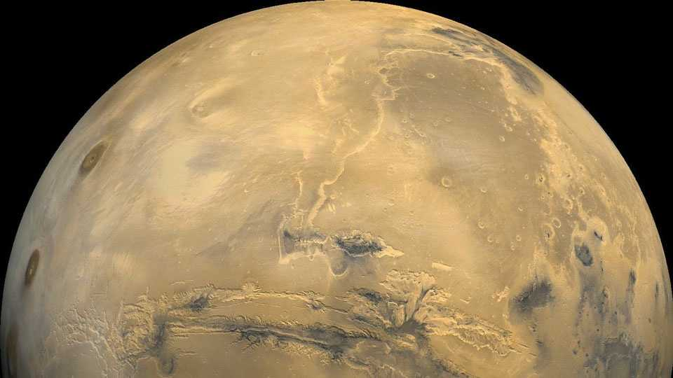 The largest canyon in the Solar System cuts a wide swath across the face of Mars. Named Valles Marineris, the grand valley extends over 3,000 kilometers long, spans as much as 600 kilometers across, and delves as much as 8 kilometers deep. By comparison, the Earth's Grand Canyon in Arizona, USA is 800 kilometers long, 30 kilometers across, and 1.8 kilometers deep. The origin of the Valles Marineris remains unknown, although a leading hypothesis holds that it started as a crack billions of years ago as the planet cooled. Several geologic processes have been identified in the canyon. The above mosaic was created  from over 100 images of Mars taken by Viking Orbiters in the 1970s.