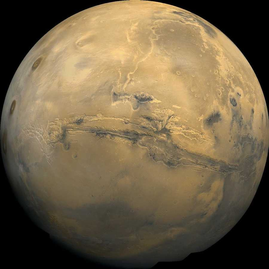 The largest canyon in theSolar Systemcuts a wide swath across the face ofMars. NamedValles Marineris, the grand valley extends over 3,000 kilometers long, spans as much as 600 kilometers across, and delves as much as 8 kilometers deep. By comparison, theEarth's Grand Canyonin Arizona, USA is 800 kilometers long, 30 kilometers across, and 1.8 kilometers deep. The origin of theValles Marinerisremains unknown, although a leading hypothesis holds that it started as acrackbillions of years ago as the planet cooled. Several geologic processes have been identified in the canyon.The above mosaic was createdfrom over 100 images of Marstaken by VikingOrbiters in the 1970s.