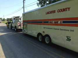 Authorities say a five-gallon container of paint and a container of hydrochloric acid spilled inside of a tractor trailer that was making a delivery to Gordonville Bookstore.