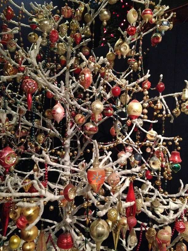 At the end of the holiday season, Pennsylvania Germans didn't want to waste trees, so they pulled off the needles and wrapped each branch in white cotton bunting. This created the effect of a snow-covered tree, and it was usable for years.