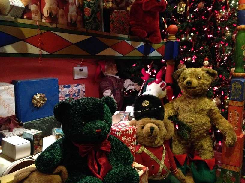 """A working conveyor belt (pictured behind toy bears) transports presents around the """"workshop."""""""