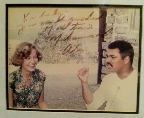 "Kim met Muhammad Ali for a PM Magazine shoot. Ali inscribed on the photo ""Kimberly, you are the greatest of all time."""