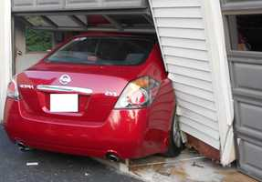 """Police stated, """"Investigation found that the driver of a red Nissan Altima, MychalJamal BROADWAY, 23 year old male, had been traveling northbound on Warren Street and crossed Walton Street where he entered the driveway striking the parked truck and crashing through the garage door. Broadway who was not injured stated that he had fallen asleep at the wheel. He was cited for Careless Driving and Driving While his License was Suspended."""""""