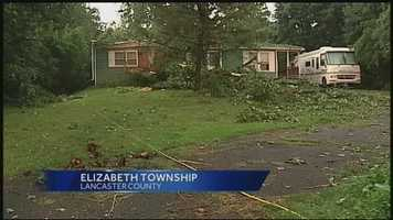 A Lancaster County woman was trapped in her Elizabeth Township home on Wednesday after severe storms knocked a tree onto her house.