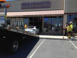 A car crashed into Highland Pizzeria in Manheim Township, Lancaster County, on Friday.