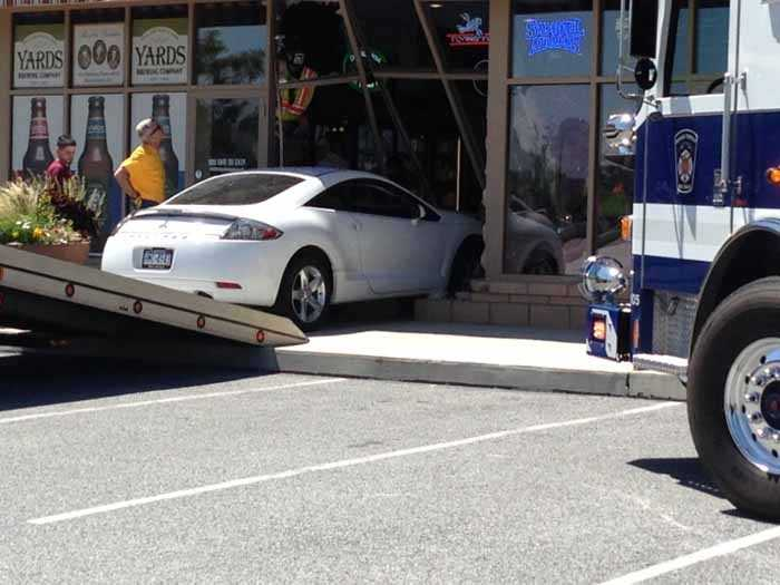 Officials said a middle-aged man put his car into drive then accidentally hopped the curb and crashed into the pizza shop.
