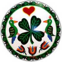 "This Irish-themed design features a shamrock and distlefink birds for good luck. The ""Trinity tulips"" are for faith: ""Faith in yourself, faith in what you do and faith in your fellow man."" The border signifies ""smooth sailing through life."""
