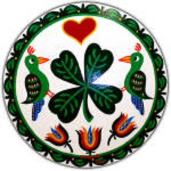"""This Irish-themed design features a shamrock and distlefink birds for good luck. The """"Trinity tulips"""" are for faith: """"Faith in yourself, faith in what you do and faith in your fellow man."""" The border signifies """"smooth sailing through life."""""""