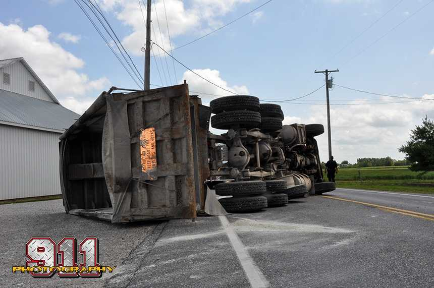 The incident occurred when a tractor trailer overturned. The driver left the bed of the truck up after dumping a load of stones, which then got tangled in utility wires. There were no injuries.