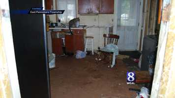 Inside, police found a dead cat, dead mice, and animal feces on the children's beds.