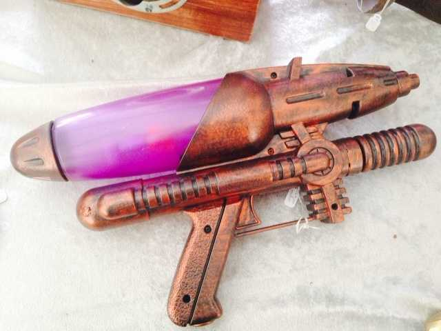 What do you see? This is actually a hand-painted water gun, created by designer MoJo.
