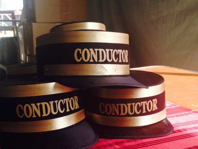 "A stack of ""Conductor"" hats."