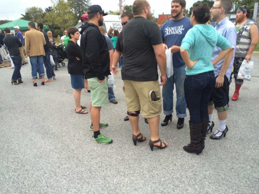 Friday night in York men walked for a mile in women's high heels to show their support for victims of domestic violence.