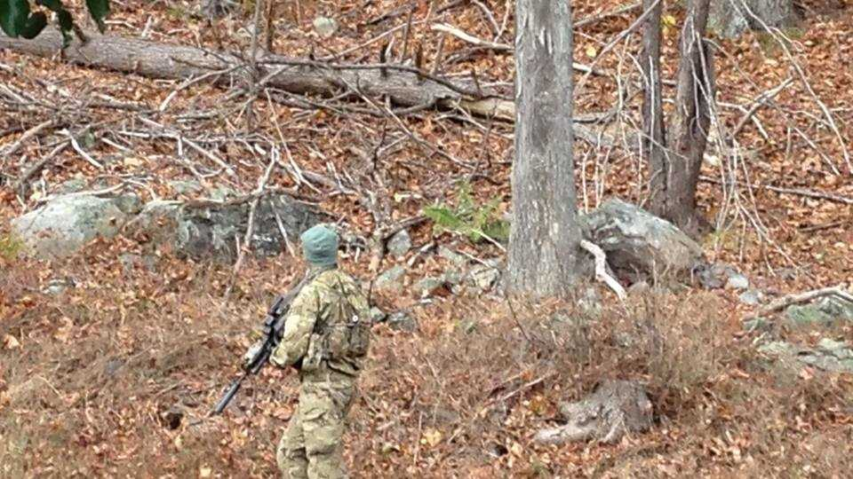 Monday, October 20, 2014: State Police search a forest area near Pocono Mountain East High School in Swiftwater, Monroe County, where Frein may have been sighted.