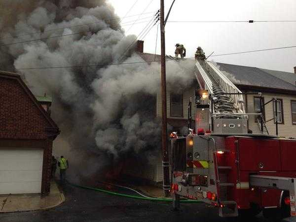 Officials say the fire engulfed three row homes along the 500 block of North 11th Street.