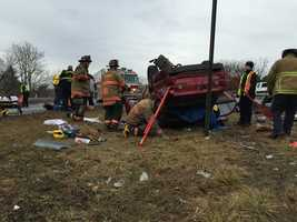 A witness tells News 8 that a car overturned and people rushed to get a female driver out of the vehicle.